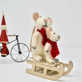 miniature toys on a sleigh